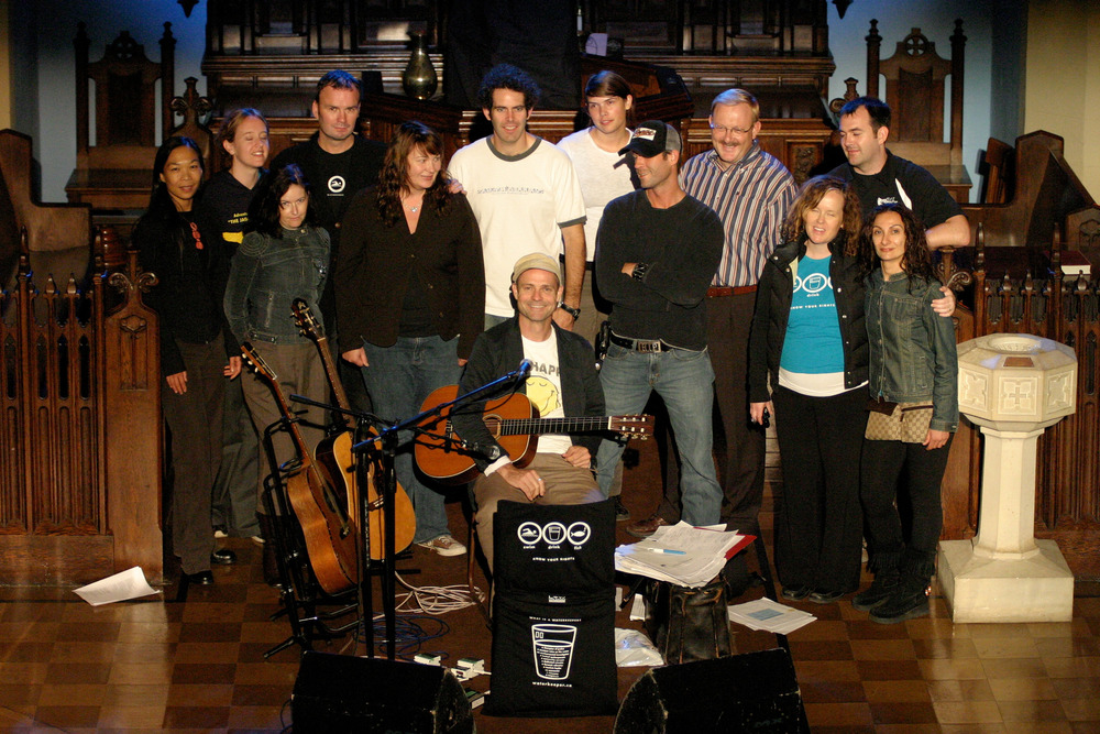 Gord Downie (centre) and Mark Mattson (third from the left, back row) with the Heart of a Lake crew after the final show of Waterkeeper's tour in 2006. Photo by Dylan Neild.