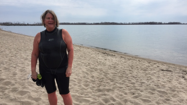 Kathleen McDonnell enjoying her frontyard, Lake Ontario. (Image via CBC)