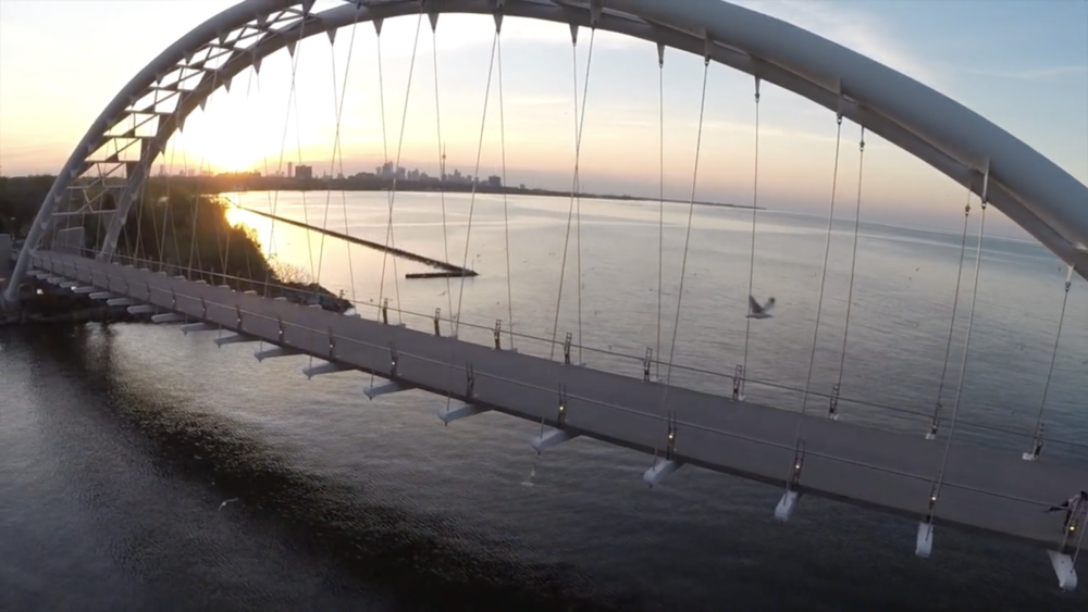 Glimpse of Toronto through the Humber Arch Bridge. (Screenshot from Accidental Parkland.)