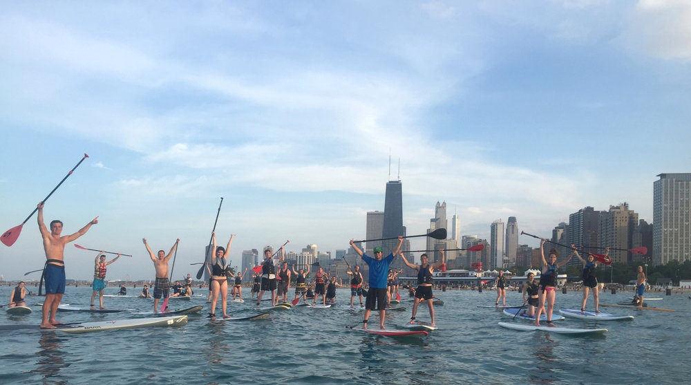 Paddlerboarders taking over Chicago's shoreline. (Photo via ChicagoSUP)