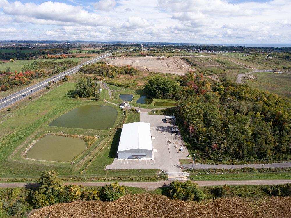 The open space seen in the background, beside the 401, is the storage site for Port Hope's low-level radioactive waste. (Photo by Dylan Neild)