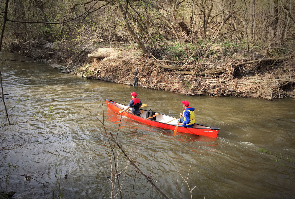 Two participants paddling along the Don River in Manulife's annual Paddle The Don. (Photo by Ruby Pajares)