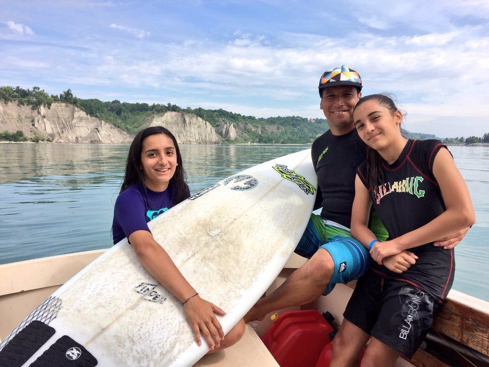 Larry Cavero and his daughters Keanna and Nailani seen here enjoying a beautiful day on Lake Ontario. Photo by Claire Lawson
