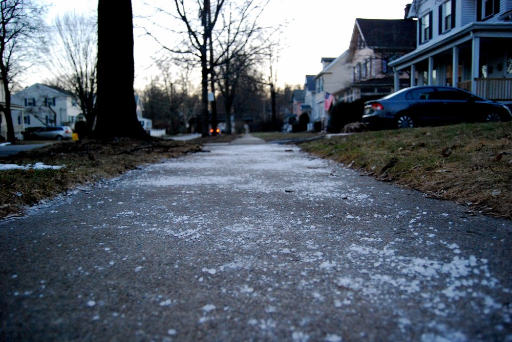 The image was taken by    markgranitz   . It illustrates the typical overuse of road salt on the sidewalks.