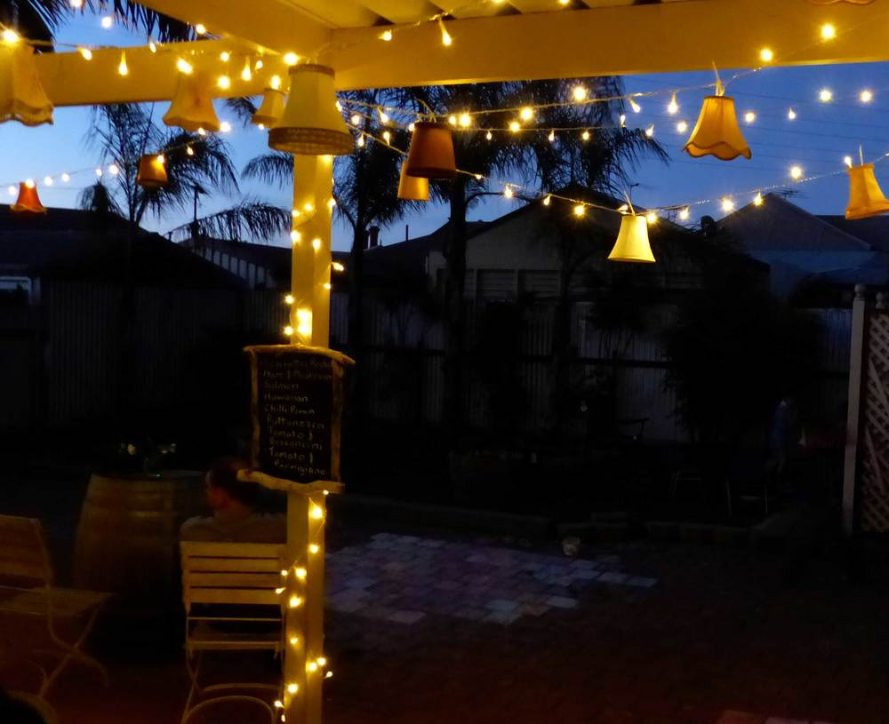 At a recent event we hung them underneath a pergola along with fairy lights.