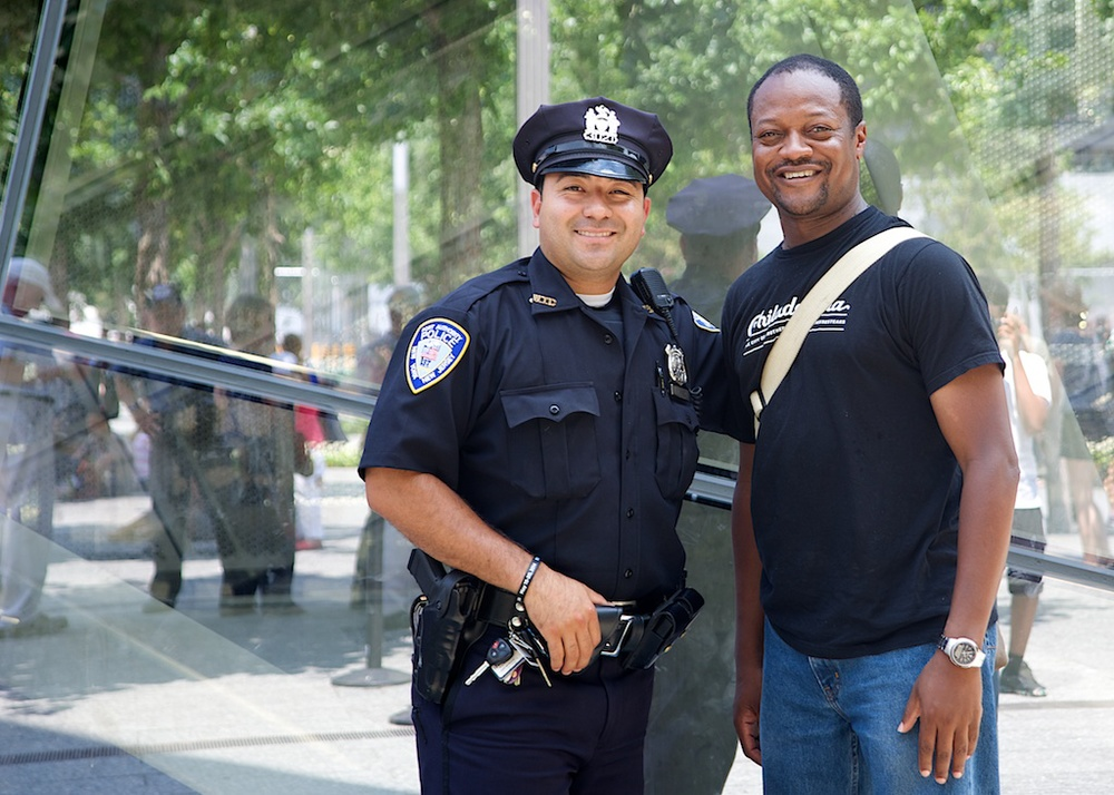 I asked this police officer if I could photograph him in front of the 911 Museum. He replied that he could only do it if were in the photo with him. I doubt that is actually a law. I could have confronted him and demanded to see proof, but I probably wouldn't have got a photo with a smile like that. Just because you can doesn't mean you should.