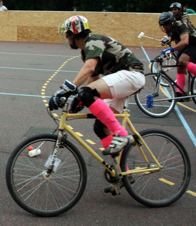 Bicycle hockey in action, with de rigueur attire..