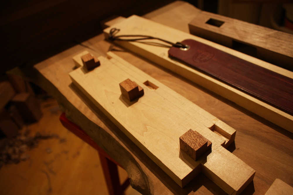 These little mahogany clips and those holes in the aprons are how the top will eventually attach to the base.