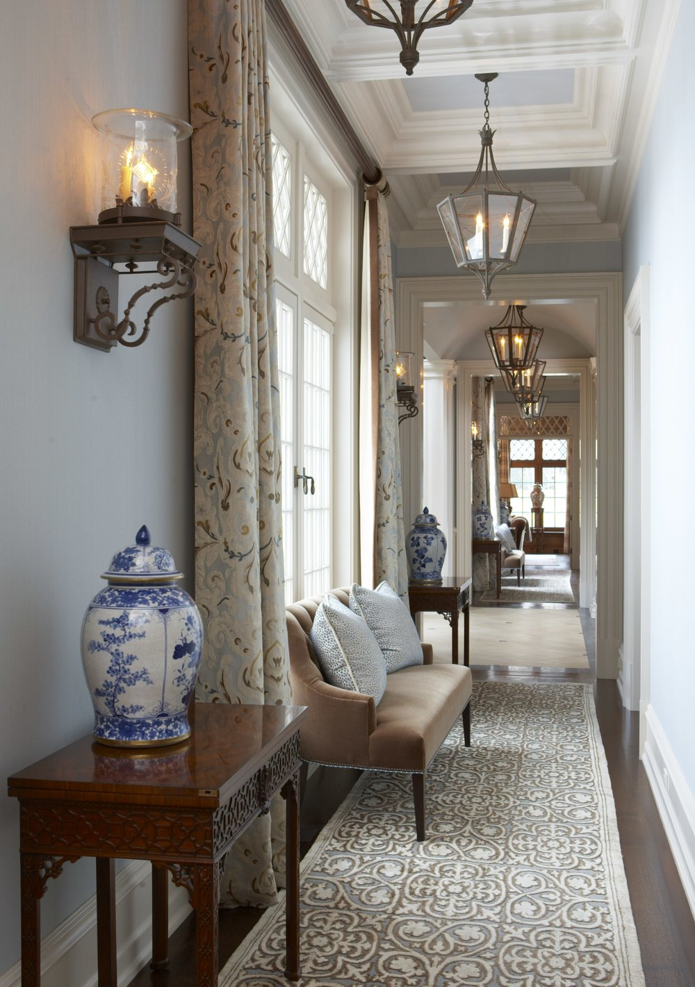 A hallway designed by Cindy Rinfret for a client's home in Greenwich, CT.