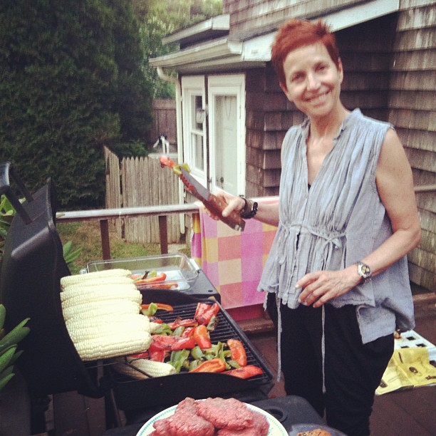 sister/partner of malia, carol, ladies the grill and beats the heat in her hepburn topwith a chic pair of vintage mm pants.