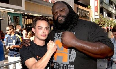 """WWE Boldest Fan"" Brandon Hendrix (left) takes poses with WWE Superstar Mark Henry (right), Hendrix took a splash from the ""World's Strongest Man"" in exchange for the WWE SummerSlam weekend of a lifetime, courtesy of Doritos JACKED."