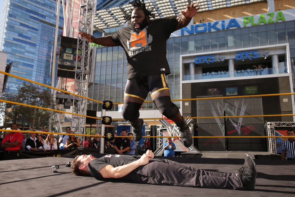 Brandon Hendrix of Portland, Ore. -- WWE's Boldest Fan contestant -- takes a splash from WWE Superstar Mark Henry, in front of the WWE Universe attending WWE SummerSlam Axxess at L.A. Live.