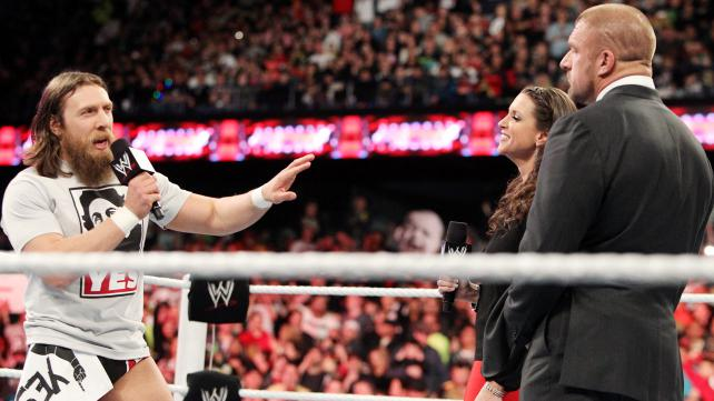 Daniel Bryan verbally jousts with Stephanie McMahon and WWE COO Triple H on Raw in April, 2014.