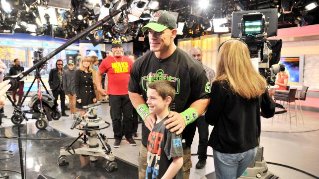 John Cena meets young fans at Good Morning America, as he promotes WrestleMania 30 in March 2014.