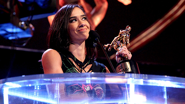 WWE Diva AJ Lee accepts the Diva of the Year award at the 2014 WWE Slammy Awards on WWE Raw.