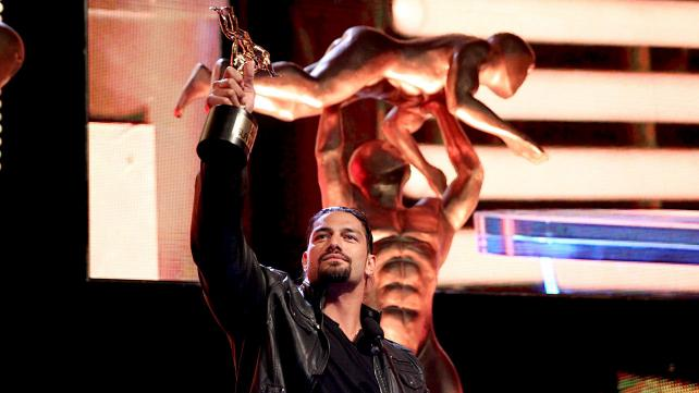 WWE Superstar Roman Reigns accepts the Superstar of the Year award at the 2014 WWE Slammy Awards on WWE Raw.