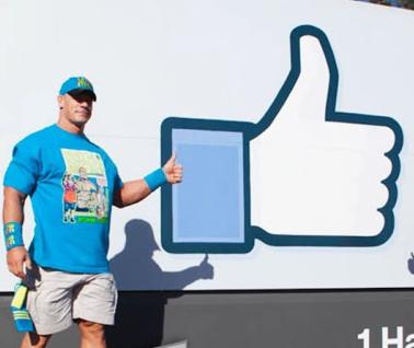 WWE Superstar John Cena poses outside Facebook HQ during WrestleMania 31 Week.
