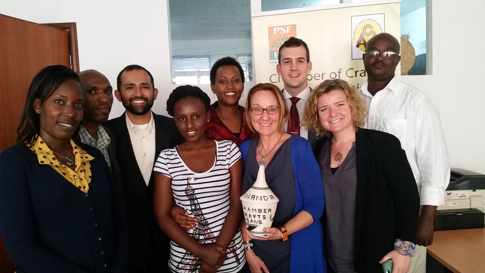 Members of the Chamber of Craft, Art and Artisans, Israel Moya from U.S. Embassy Kigali, Chase Ballinger from the State Department, and Peggy Clark and Katie Drasser from the Aspen Institute