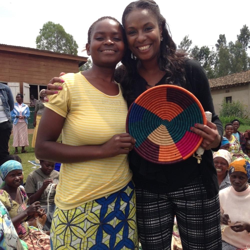 Director of Global Programs, Natika Washington visits with a weaver at the Kayonza cooperative