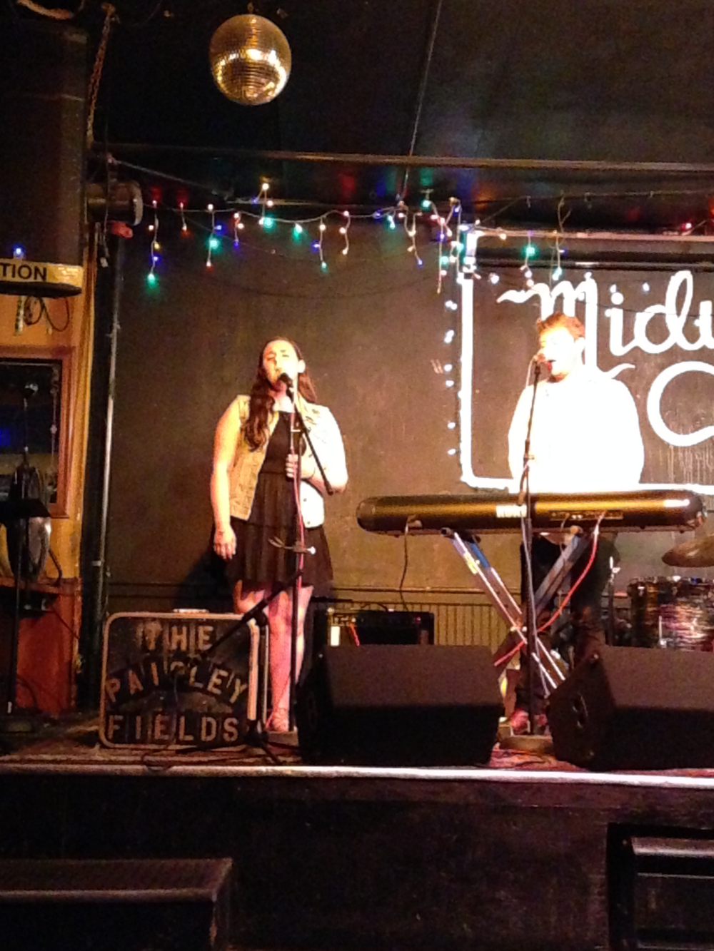 The Paisley Fields on stage at Midway Cafe in Boston. We are doing this tour as a duo. Photo by Sam Garkow.