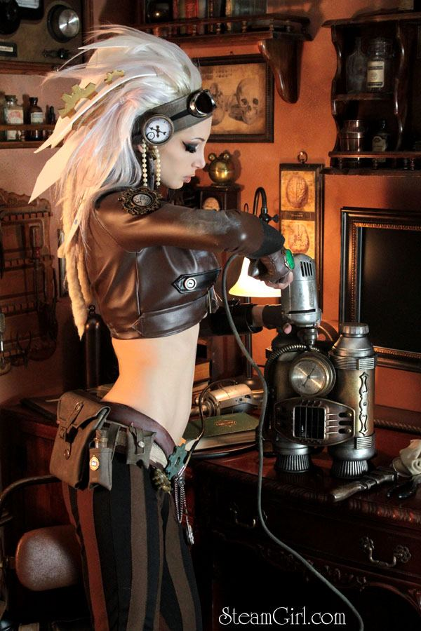 "The poster hanging on the mancandy's office wall, signed from his ""steampunk girlfriend"", Kato."
