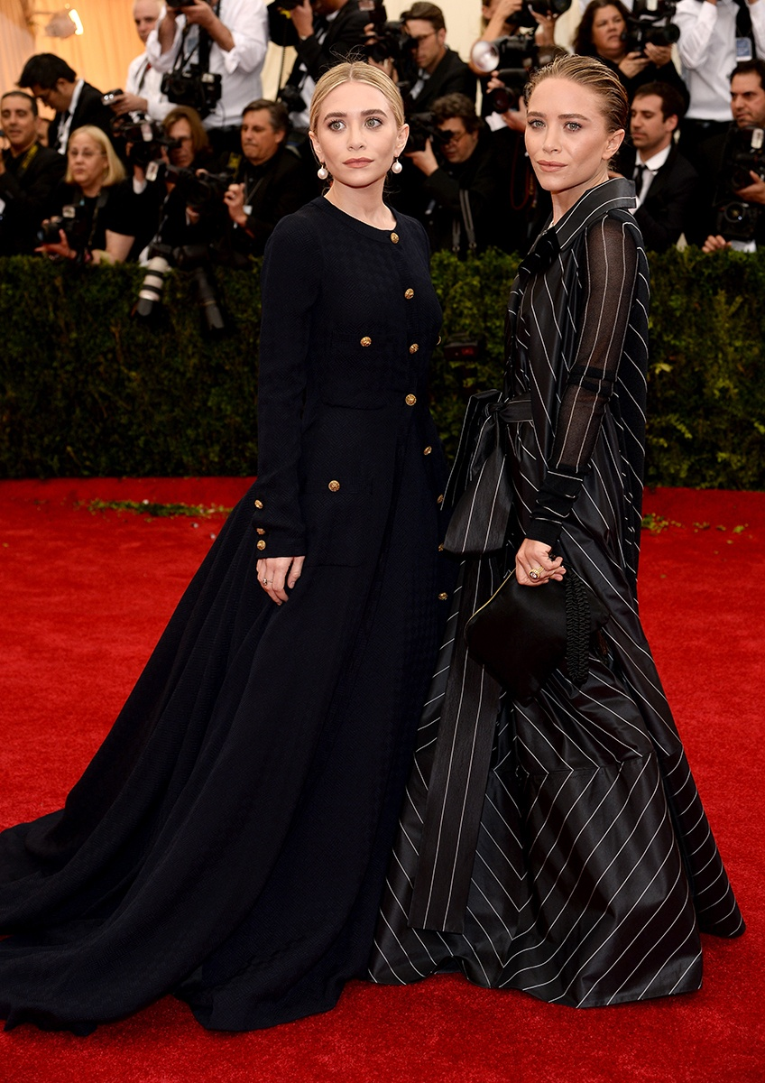 The Olsen twins, proving once again, that they ARE twins.
