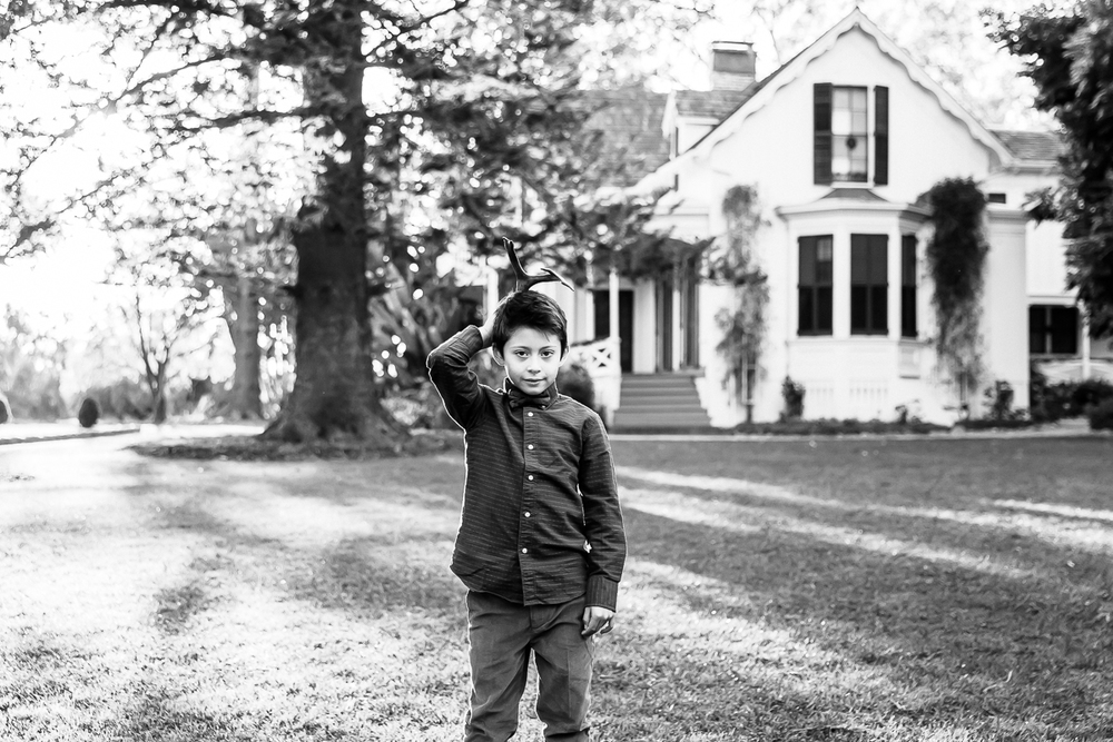 Image from a Family Session with a little boy standing and looking to camera