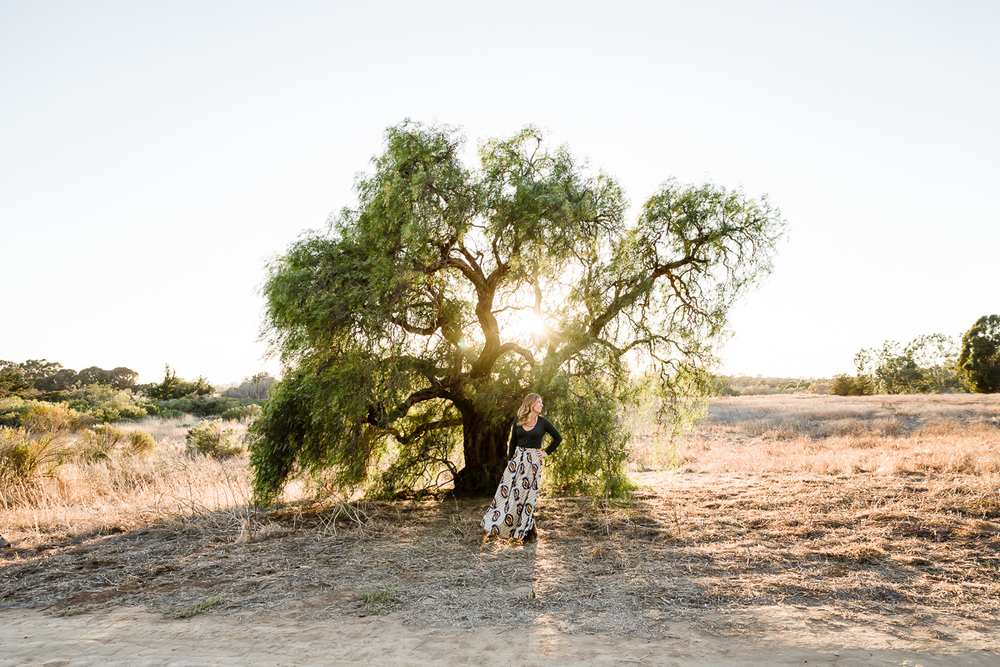 Image from a Family Session with a woman standing in front of a tree