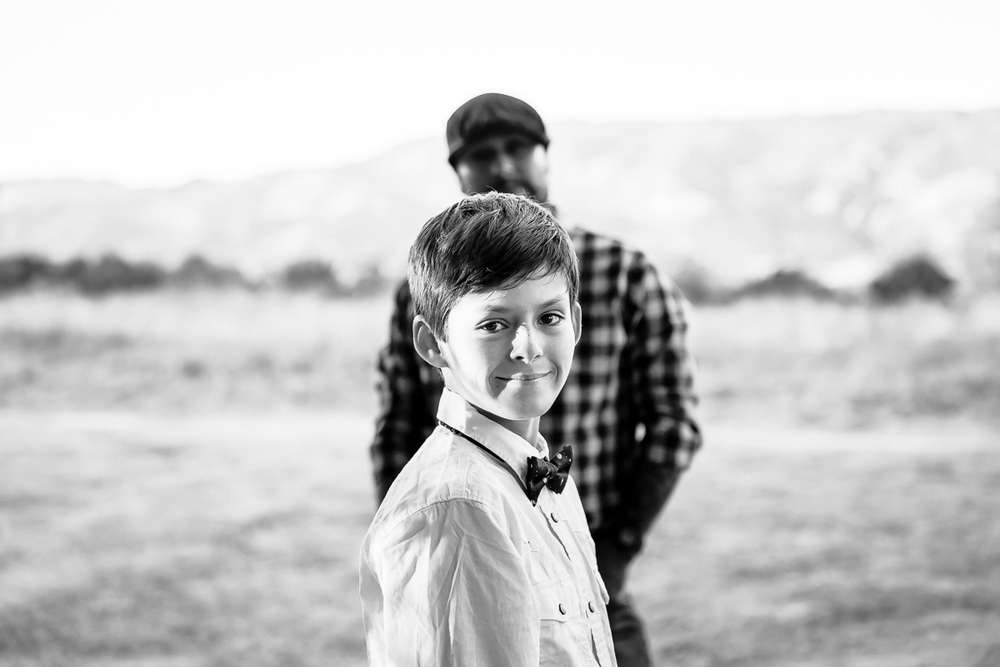 Image from a Family Session with a boy with his father behind him