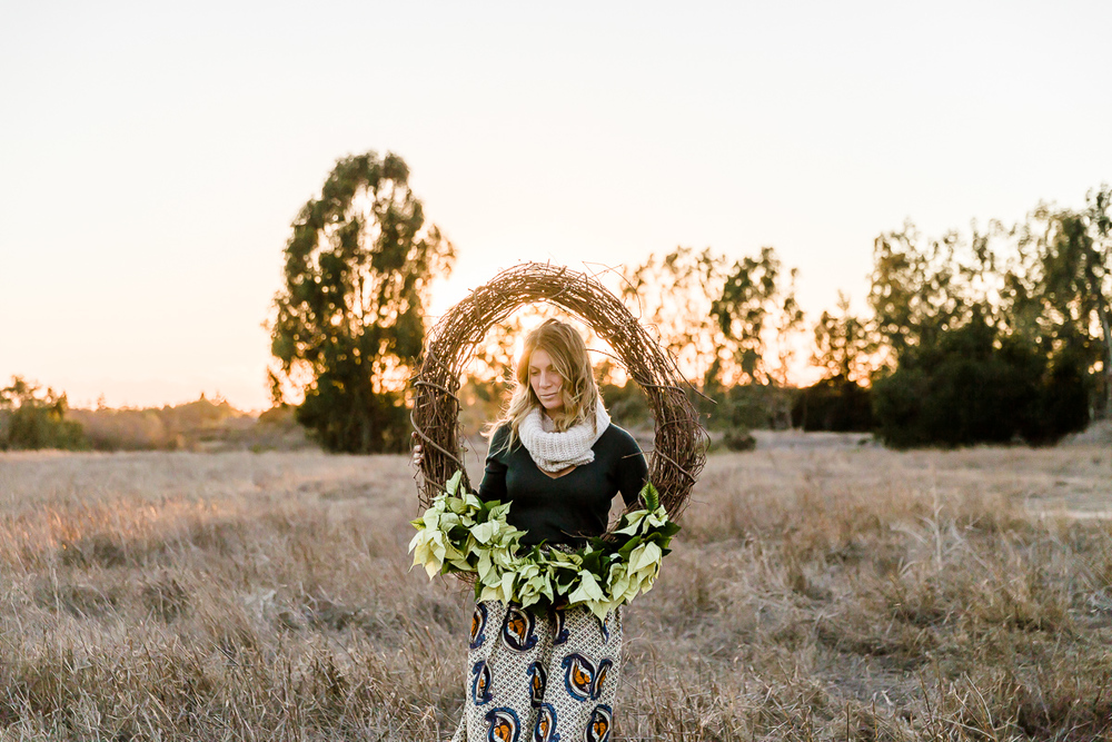 Image from a Family Session with a woman holding a wreath