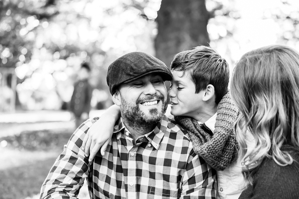 Image from a Family Session with a boy about to kiss his father's cheek