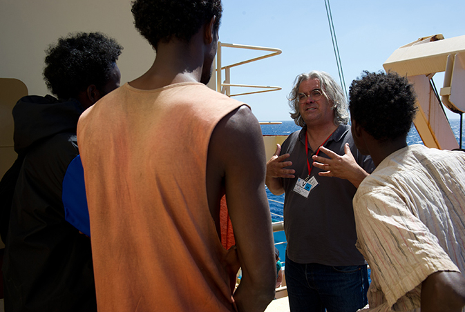 PHOTO CREDIT: Above photo (from here) features director Paul Greengrass on the set of Captain Phillips with Barkhad Abdi and other actors.