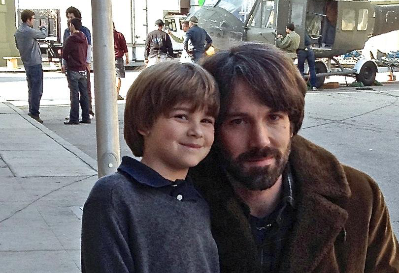 Image of Ben Affleck and young Aidan Sussman on the set of Argo via  Google .