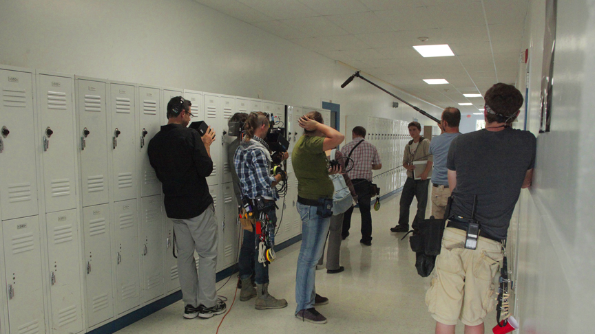 PHOTO CREDIT: Behind-the-scene photo of the crew filming a scene with Callan McAuliffe inside the Van Buren school - photo from the  movie's official website  .
