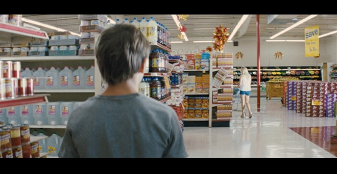 PHOTO CREDIT: Above screenshot is of Ellis as he follows Juniper (Witherspoon) around inside the Piggly Wiggly.