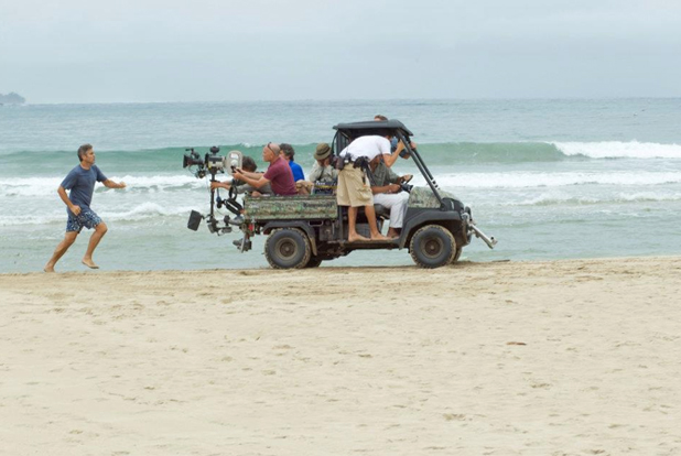 PHOTO CREDIT: A behind-the-scene look of George Clooney (as Matt King) running on the beach by the Hanalei Bay - photo from here.