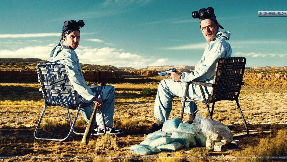 Production still from Breaking Bad of Aaron Paul and Bryan Cranston - with the iconic Albuquerque landscape behind them. Image via Google.