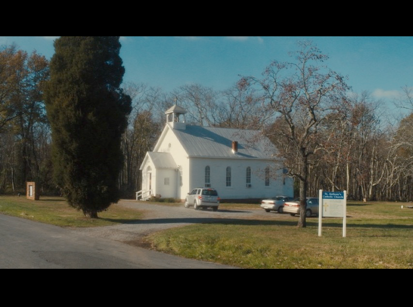 Screenshot from  Philomena  of the church where Philomena and Martin stopped in for a brief visit. In real life this location is St. Paul's Community Church in Poolesville, MD.