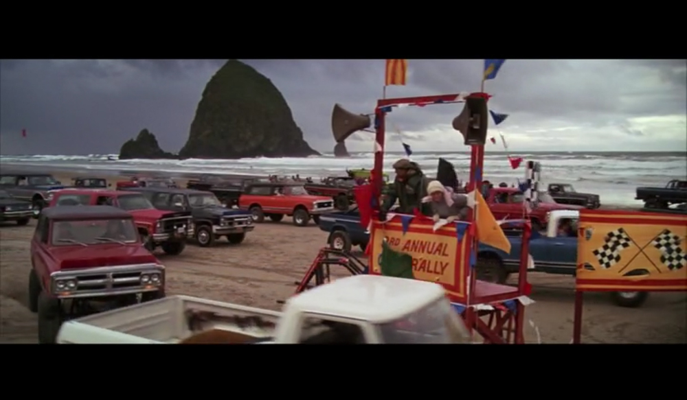 Screenshot of the truck rally scene in  The Goonies  filmed by Haystack Rock (in the background) on Cannon Beach.