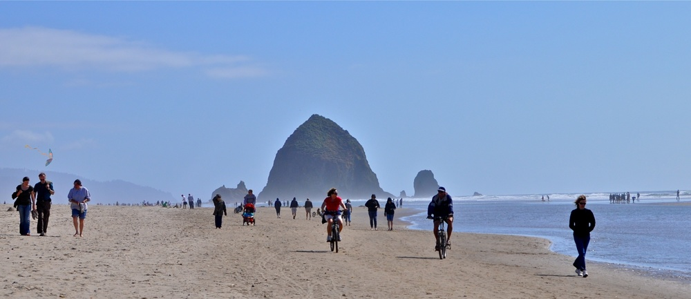 The beautiful and super-wide beach of Cannon Beach by Haystack Rock - image via  Google .