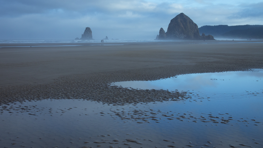 Dawn by Haystack Rock on Cannon Beach, where the truck rally sequence in  The Goonies  was filmed. Photography by Sarah Le for LocationsHub. All rights reserved.