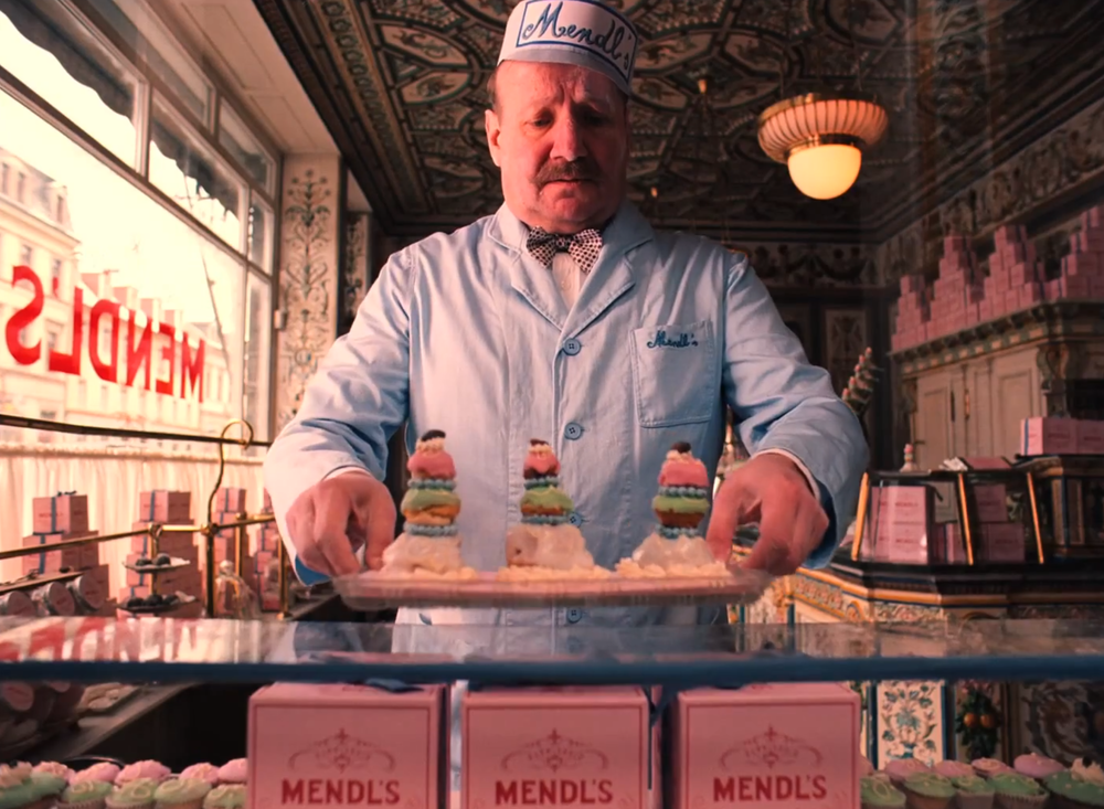 Production still of a scene at the lovely bakery shop Mendl's. Image via  Google .