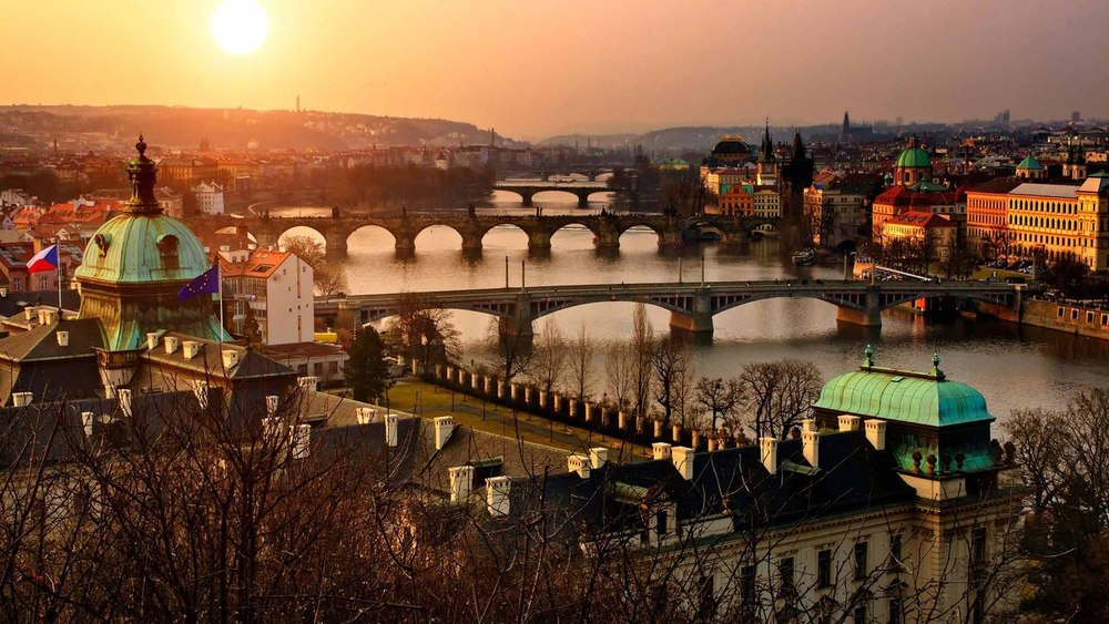 The beautiful city of Prague (the true inspiration for  The Grand Budapest Hotel  even though it wasn't filmed there) at sunset - image via  Google .