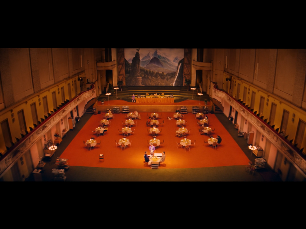 Screenshot from the movie of the private dinner between Zero and the Author, filmed at the Stadthalle.