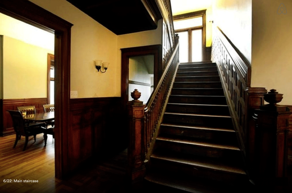 The same stairway at 82 Alfred Street as it looks now - post-renovation by its current owner Jeff Cowin. Image via Airbnb.com.