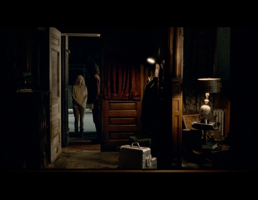 Screenshot from the movie of Eve's arrival at Adam's house - the setting is Adam's living foyer and living room.