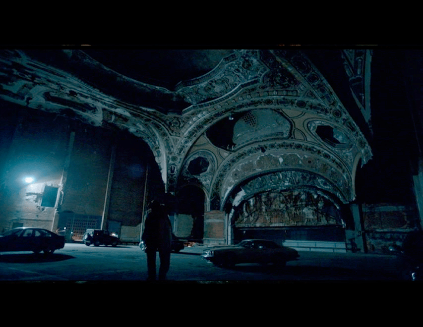 Screenshot from the movie of Adam and Eve at the Michigan Theater car park.