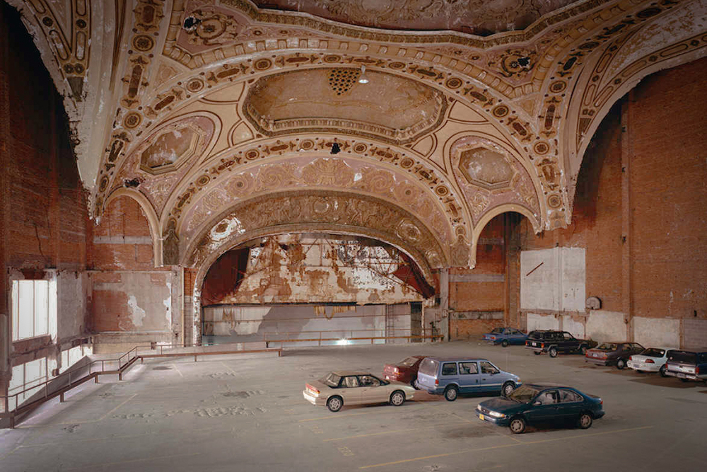 The formerly beautiful Michigan Theater is now a car parking lot in Detroit. Image via Google.