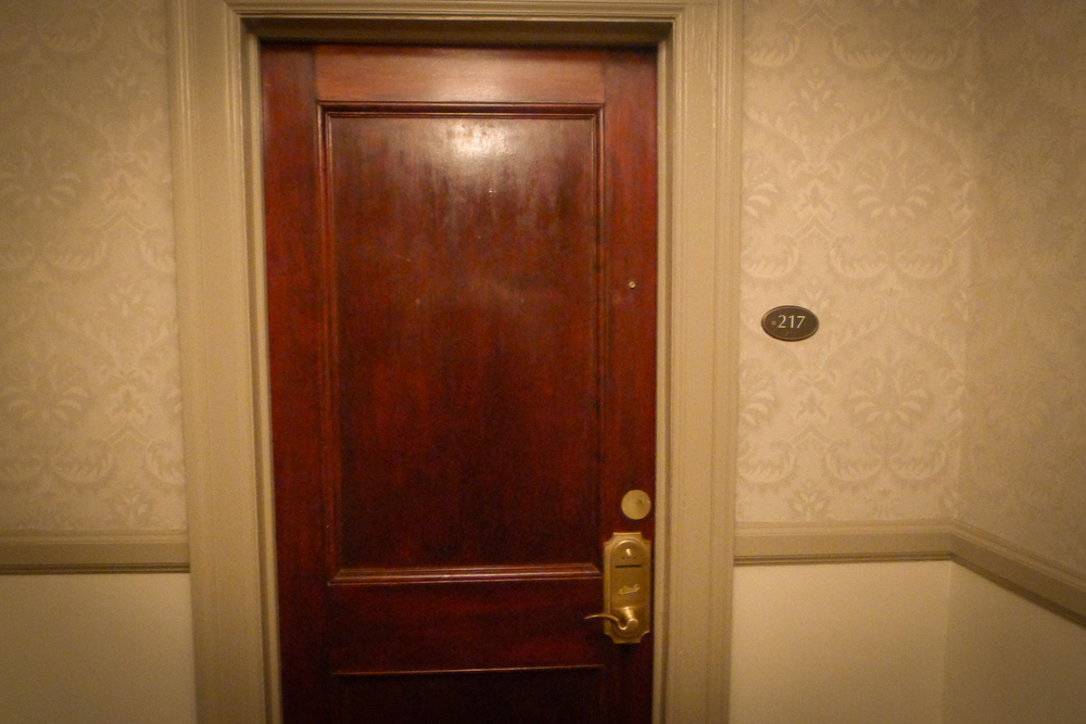 The door to Room 217 at the Stanley Hotel. Image via  Google .