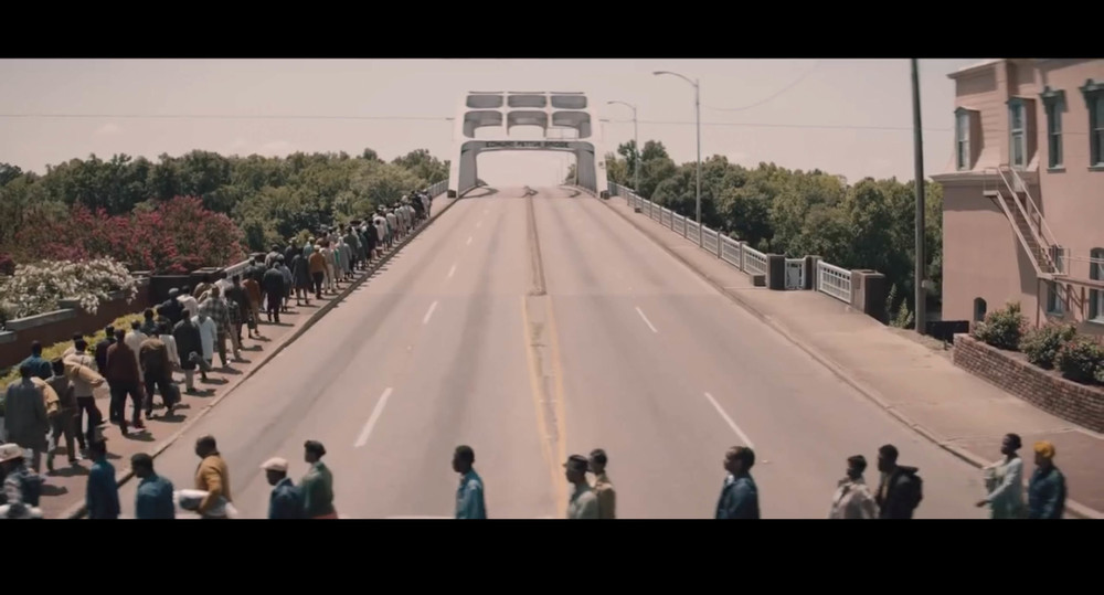 Screenshot from  Selma  of the march scene filmed on location at the Edmund Pettus Bridge in Selma, Alabama.